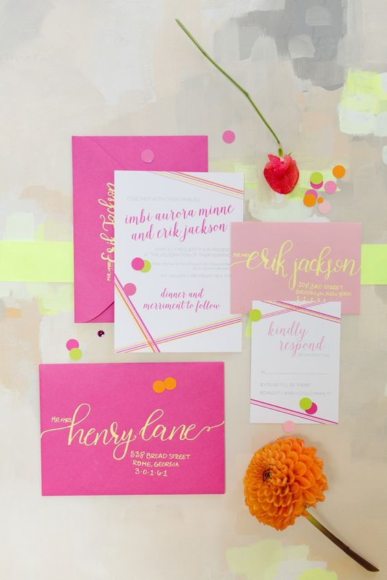 a chic modern neon wedding invitation suite in neon pink and yellow, with polka dot prints and stripes