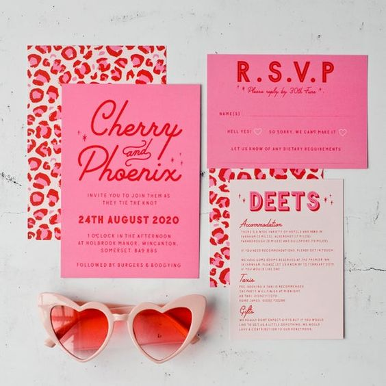 a colorful and fun wedding wedding invitation suite with hot pink invites, leopard print touches and cool letters