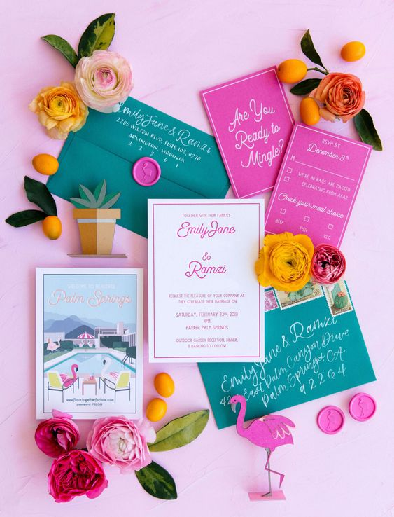 a colorful tropical wedding invitation suite with teal envelopes and hot pink invites, with bright letters and calligraphy