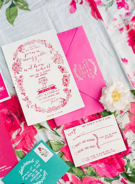 a lovely fuchsia and emerald wedding invitation suite with gold letters, with floral patterns is contrasting and cool