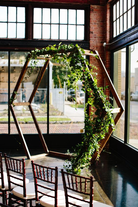a lovely spring hex wedding arch decorated with greenery is a simple and very cool idea that feels and looks fresh