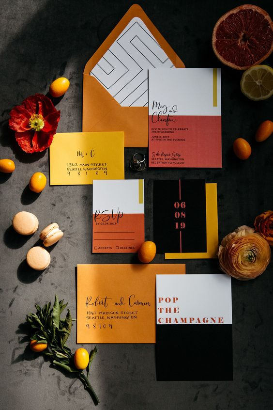 a stylish and super bold wedding invitation suite with rust-colored envelopes, black and burgundy color block invites is amazing