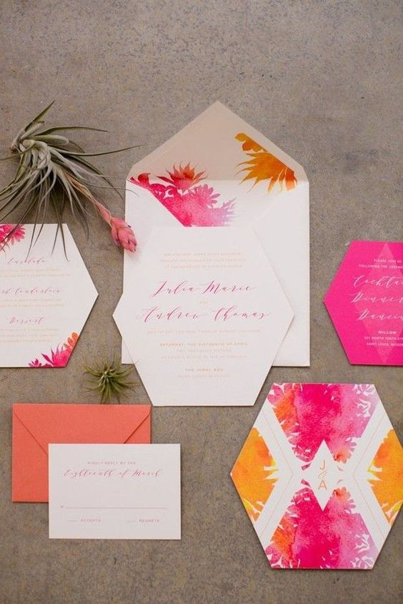 a super bold watercolor wedding invitation suite with yellow and hot pink prints, floral and geometric ones