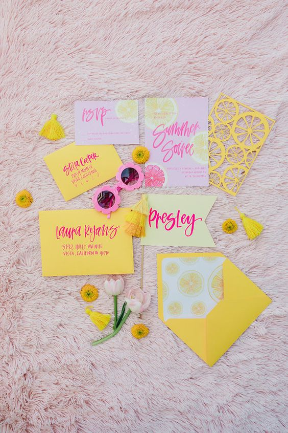 a vibrant beach wedding invitation suite in sunny yellow and light pink, with citrus prints, with bold calligraphy