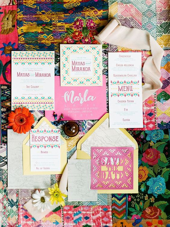 a vibrant wedding invitation in pink, green and yellow, with laser cut and bold geometric and botanical prints