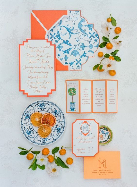 a vibrant wedding invitation suite with orange envelopes, orange edge and blue patterns inspried by azulejo tiles