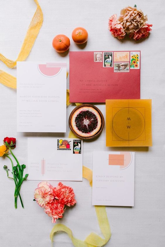 bright wedding stationery with a pink envelope, a mustard invite and some color block prints is amazing for a summer wedding