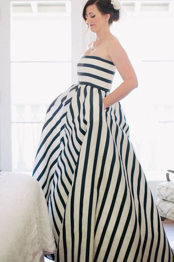 a striped nautical wedding ballgown with pockets is a lovely and bold idea for a nautical wedding and it looks one-of-a-kind