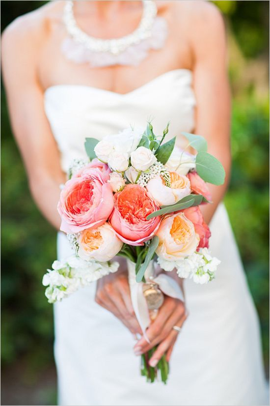 a bright nautical wedding bouquet of pink and peachy blooms, some small white roses and greenery is an amazing idea
