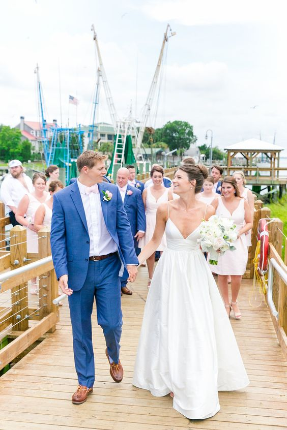 a modern take on a classic nautical wedding dress - a plain wedding ballgown with spaghetti straps and a deep neckline plus a pleated skirt