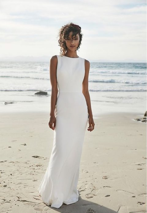 a minimalist yet classic white sheath dress with a high neckline and no sleeves is a classic and modern idea for a nautical wedding