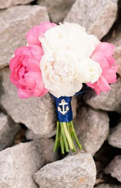 a simple and cute pink and white peony wedding bouquet with a navy anchor wrap is a gorgeous idea for a nautical wedding