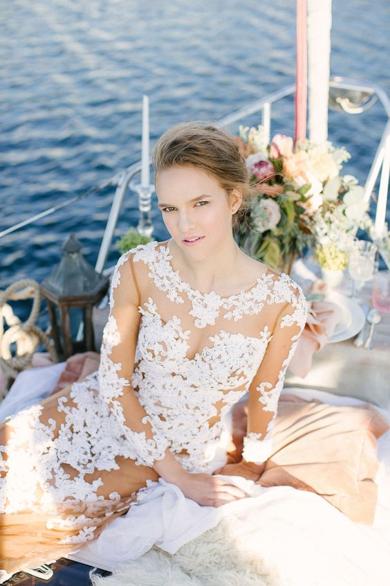 a chic and sexy nude fitting wedding dress with white lace strategically placed on the bodice, skirt and sleeves is wow