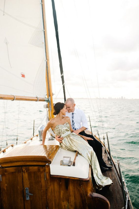 a gold sequin strapless A-line wedding dress with a pleated bodice and train is a lovely idea for a nautical wedding