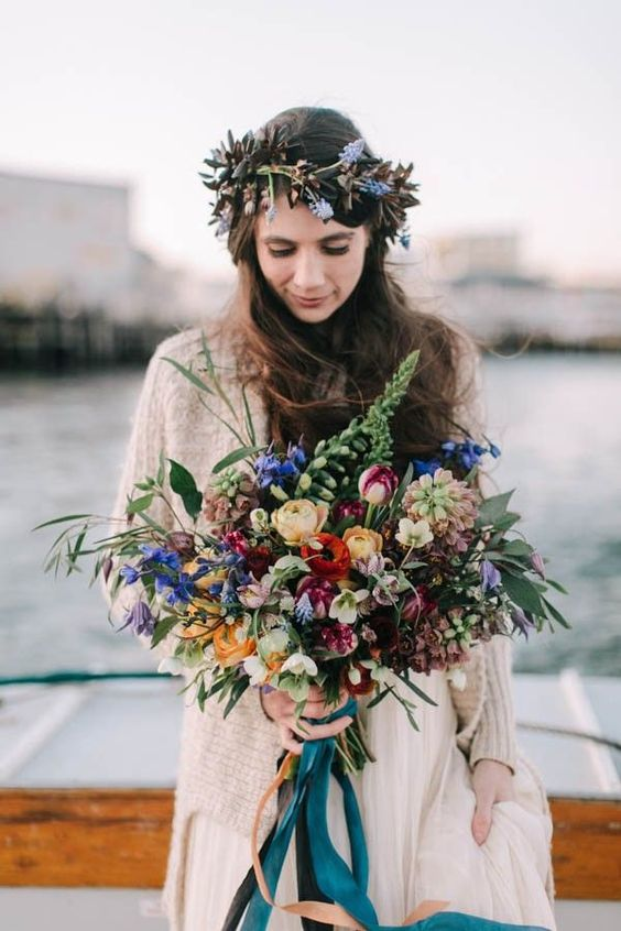 a bright nautical wedding bouquet with blue, purple, burgundy, yellow, pink and white blooms and greenery for a boho nautical bride