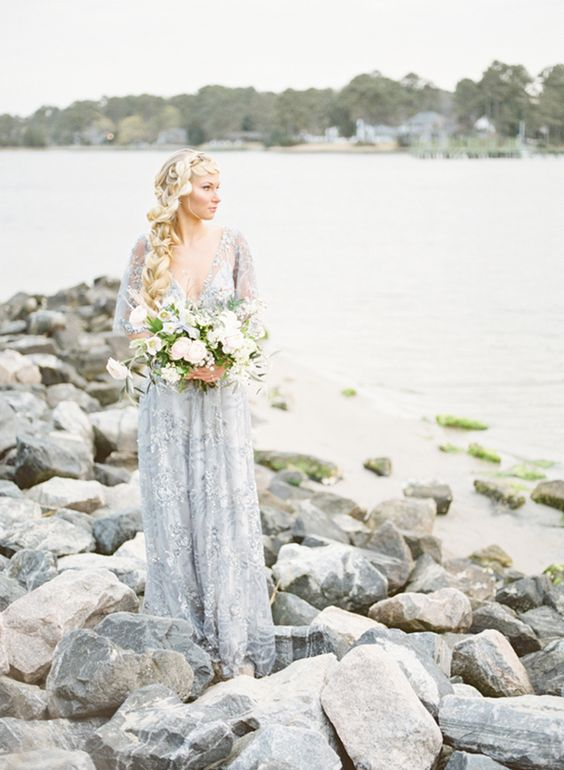a grey lace fully embellished wedding dress with a deep neckline, long sleeves for a modern and delicate nautical wedding