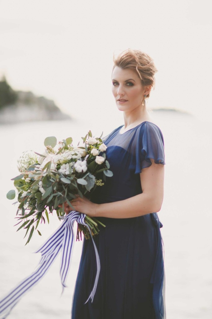 a modern navy A-line wedding dress with an illusion neckline, cap sleeves is a very elegant and fresh solution