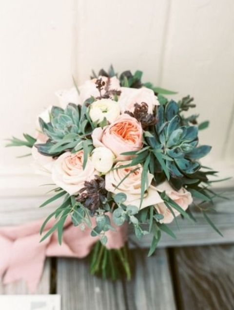 a blush nautical wedding bouquet of peonies and roses, succulents and dark and usual green foliage plus dusty pink ribbons