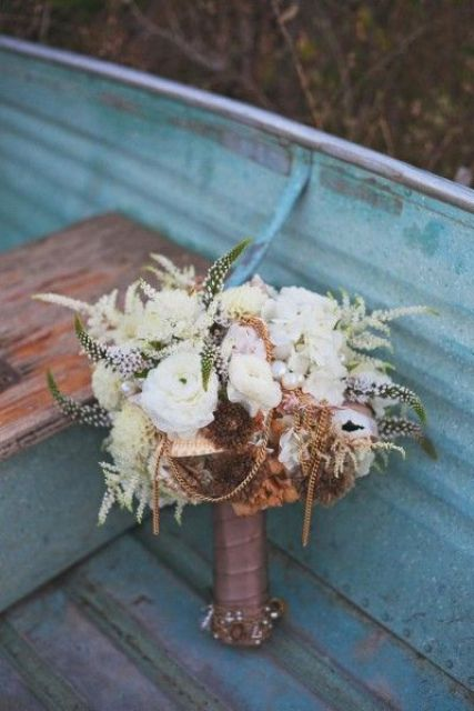 a creative nautical wedding bouquet with white blooms, astilbe, pearls, chains and some dried flowers is amazing