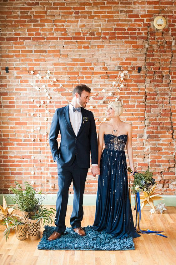 a strapless navy A-line wedding dress with gold leaf is a gorgeous idea for an elegant and chic nautical wedding
