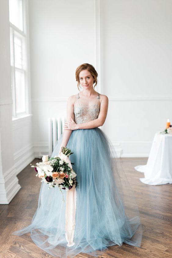 a romantic coastal wedding dress with a neutral embellished bodice, a blue tulle layer skirt is a delicate and chic idea