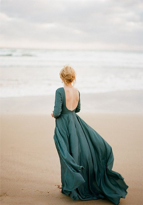 a slate blue A-line wedding dress with long sleeves and a cutout back plus a small train is a cool and fresh idea
