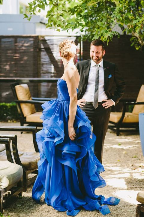 an electric blue wedding dress with a draped bodice and a tiered ruffle skirt with a train is a gorgeous statement