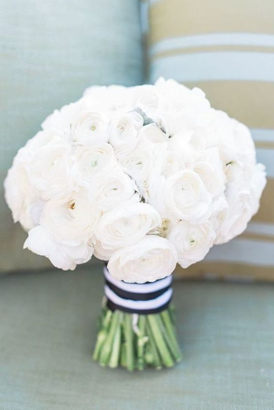 a white peony rose wedding bouquet with a wide striped ribbon is a classic idea for a nautical wedding