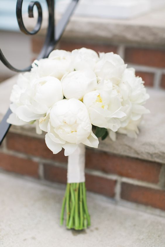 a white peony wedding bouquet with a white wrap is all-time classics for a nautical or any summer wedding
