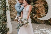 a beautiful A-line wedding dress with a fully embellished bodice and no sleeves, a layered tulle skirt with a train is dreamy