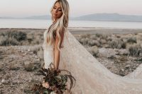a beautiful blush A-line wedding dress with a train and a super long capelet, with white stars embroidered is a gorgeous idea