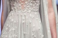 a beautiful grey A-line wedding dress with an illusion high neckline, long cut sleeves and sparkling stars all over the dress