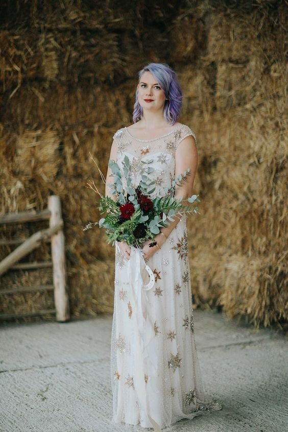 a beautiful sheath wedding dress fully embellished with silver and gold stars and an illusion high neckline is a fantastic idea