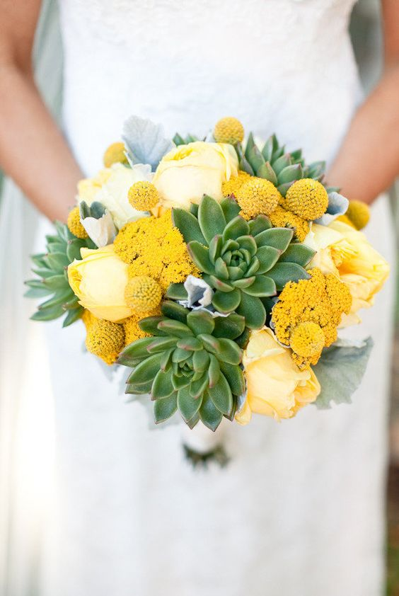 a bold wedding bouquet of succulents, yellow peonies, billy balls and pale leaves is a chic and bold idea to try