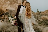 a breathttaking celestial A-line wedding dress with a cutout back, bell sleeves, a long train and silver scales all over the gown