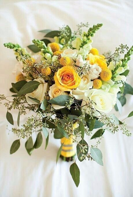 a bright spring or summer wedding bouquet of white and yellow roses, billy balls, greenery and astilbe is amazing