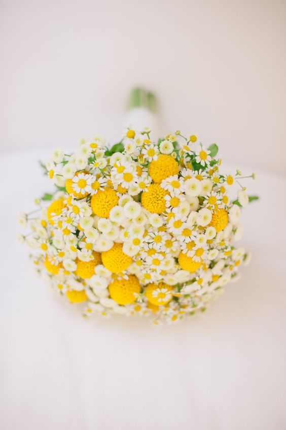 a bright wedding bouquet of billy balls and daisies is a lovely idea for a relaxed summer wedding or a spring one