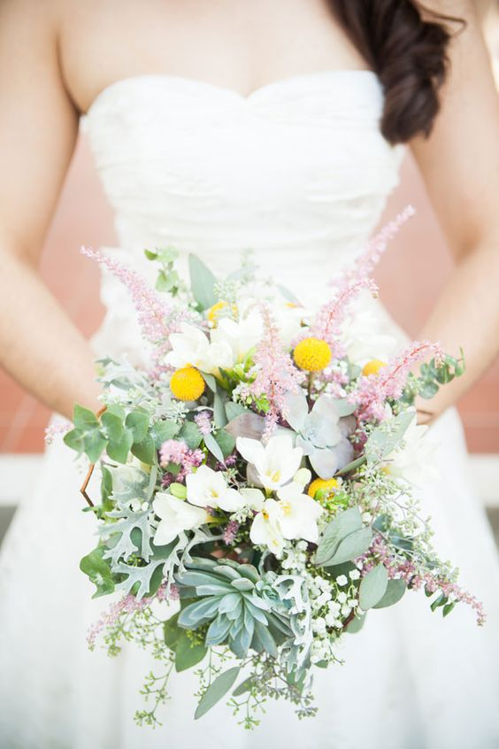 a creative and dimensional wedding bouquet with billy balls, astilbe, succulents, greenery and white blooms is a pretty and lovely idea
