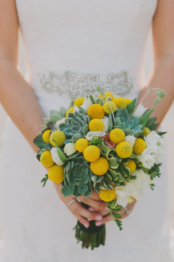 a cute wedding bouquet of white blooms, billy balls, succulents is a lovely and simple idea for a spring or summer wedding