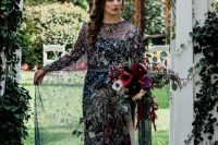 a dreamy navy sheath wedding dress with a high illusion neckline and a capelet, embroidered stars, planets and constellations that are sparkling silver