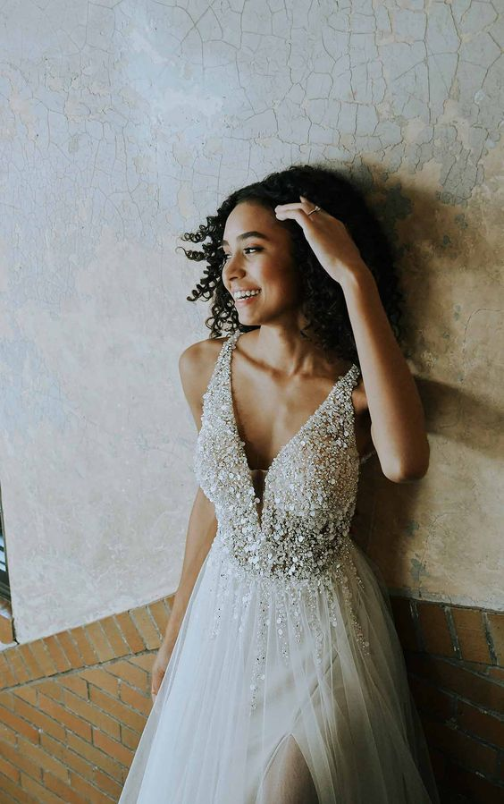 a glam A-line wedding dress with a sparkling bodice, thick straps and a layered skirt with a touch of sparkle is a gorgeous idea