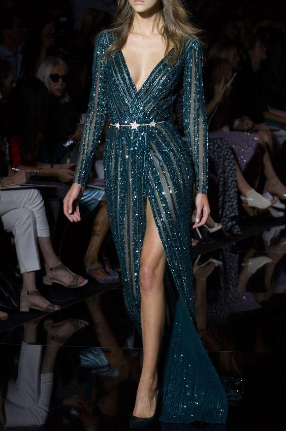 a jaw-dropping dark green sparkling wedding dress with a deep neckline, a thigh high slit and a silver star belt just wows