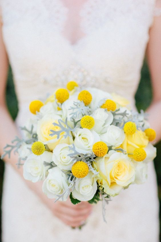 a laconic and chic wedding bouquet with white roses, billy balls, pale leaves is a great idea for a winter to spring wedding