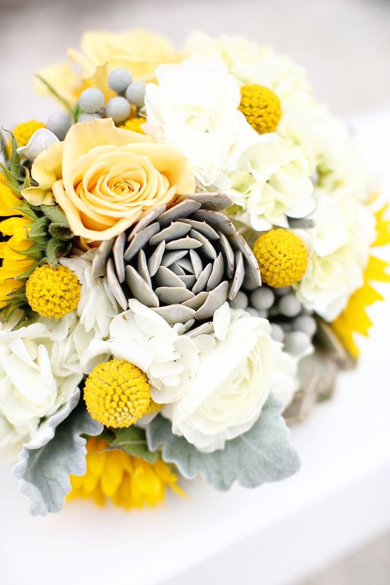 a lovely billy ball wedding bouquet with yellow and white blooms, pale leaves, berries and billy balls for a grey and yellow wedding