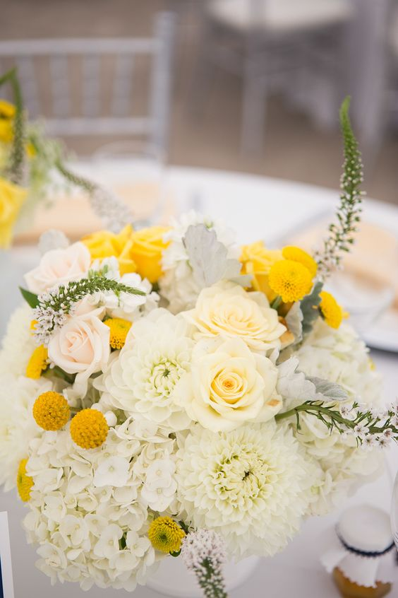 a lush summer wedding centerpiece of white and blush blooms, billy balls and astilbe is a pretty idea to rock