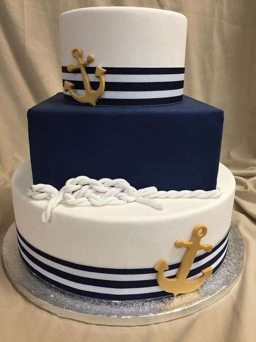 a nautical wedding cake with navy stripes and a navy tier, rope and gold acnhors is a gorgeous idea to rock