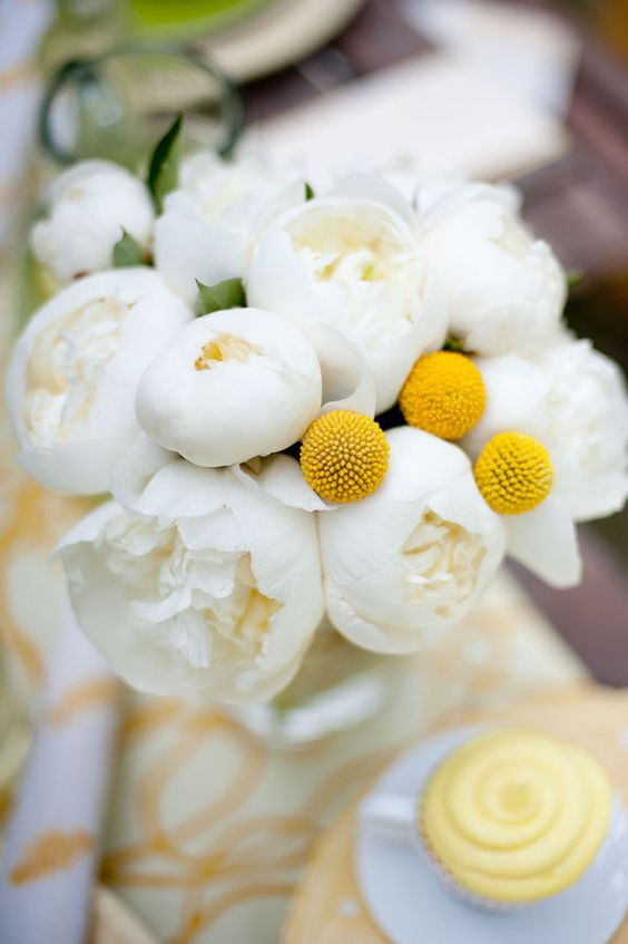 a pretty and simple summer wedding bouquet of white peonies and billy balls is a great solution for a summer bride