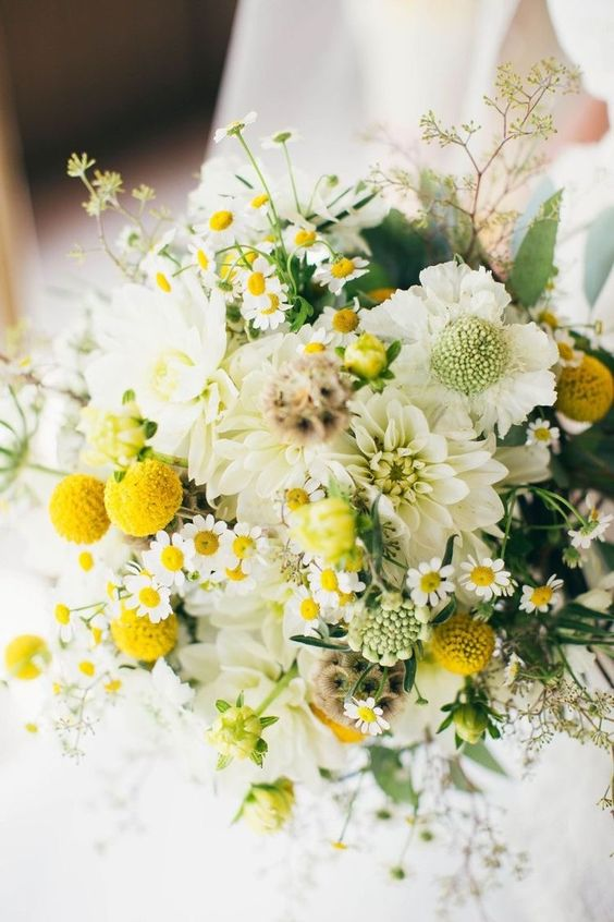 a pretty and very fresh wedding bouquet with billy balls, greenery, seed pods, white blooms for a relaxed summer wedding