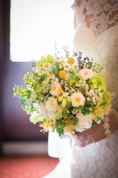 a pretty ball-shaped wedding bouquet with white blooms, billy balls, lavender, greenery is a perfect idea for a relaxed summer wedding