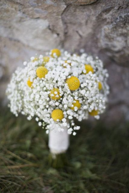 a rustic wedding bouquet of baby's breath and billy balls is a very lovely and almost classic idea for any country bride